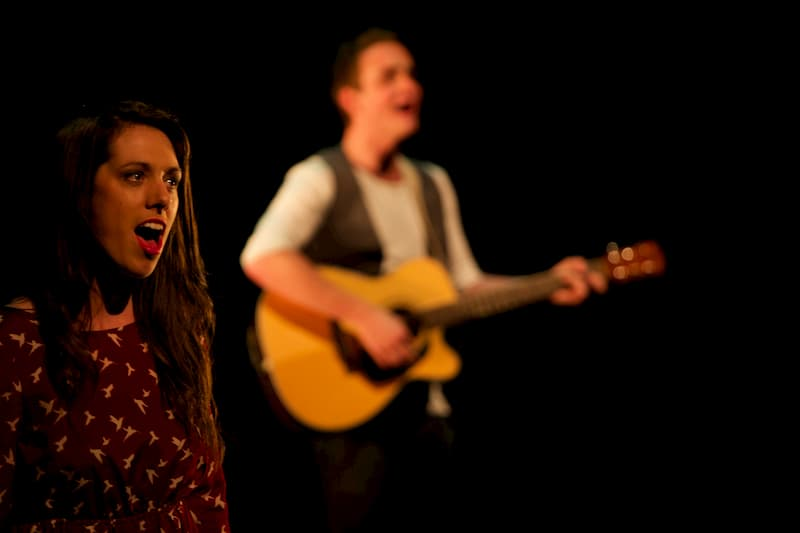 Musical Theatre Short Course student singing with guitarist